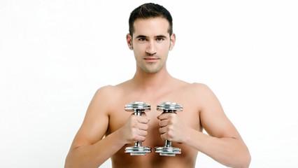 deportista con mancuernas